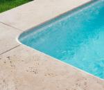 piedra natural en coronación piscina